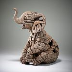 Edge Carved Baby Elephant Sculpture