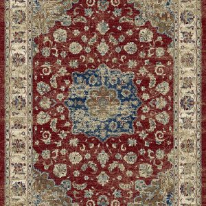 Traditional patterned rug with a border. Blues, creams rusts on a red background