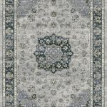Traditional patterned rug with a border. Blues, silver on a grey background