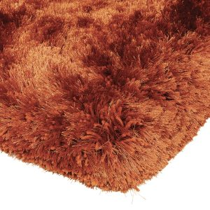 Heavy weight shaggy rug in a strong orange/rust colour